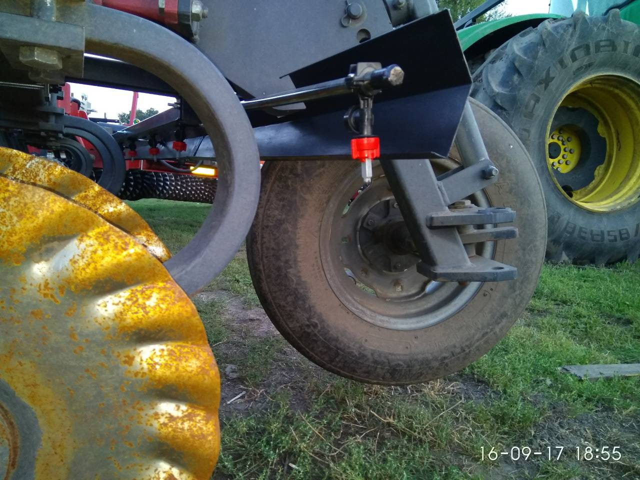 Re-equipped disc harrow with nozzles