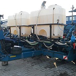 Reequipping of the soil-cultivating and sowing machines for applicating of the liquid fertilizes